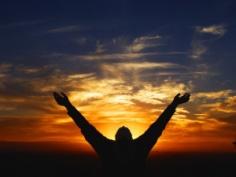 hands raised to heaven
