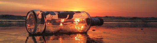 cropped-bottle-on-beach.jpg